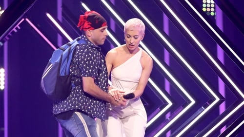 SuRie was joined by a stage invader during Eurovision Final