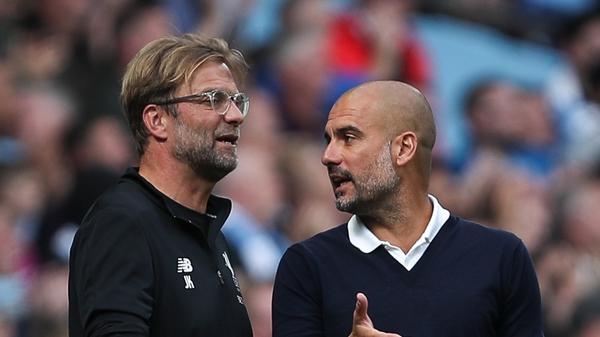 Jurgen Klopp (L) and Manchester city boss Pep Guardiola