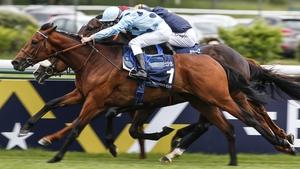 Cristian Demuro riding Olmedo (nearest, blue) wins The Emirates Poule d'Essai des Poulains at Longchamp