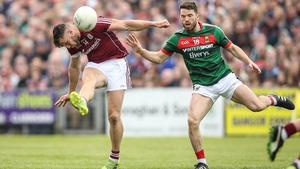 Galway's Damien Comer get his shot away despite pressure from Chris Barrett