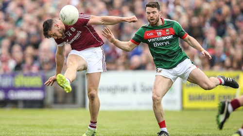 Galway's Damien Comer get his shot away despite pressure from Chris Barrett