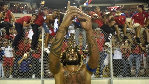 Roman Torres takes a selfie with the fans celebrating after he scored the goal that sent Panama to Russia