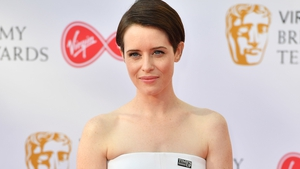Claire Foy attends the British Academy Television Awards wearing a Time's Up Pin
