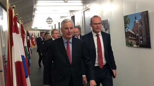 Tánaiste Simon Coveney (R) and the EU's Michel Barnier in Brussels