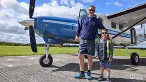Neil Bowditch, alongside seven-year-old Kacper Kacprzak (Pic: GoFundMe)