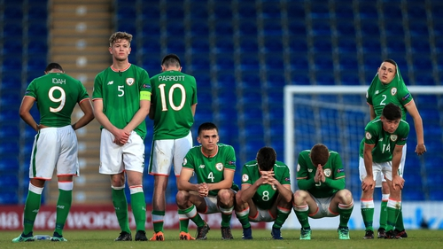 Ireland captain Collins (5) and his team mates after defeat