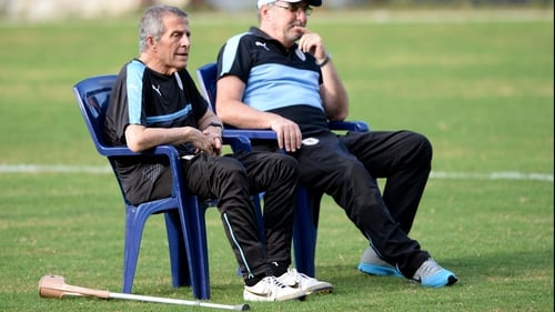 Tabarez watches training from a seat with a crutch by his side