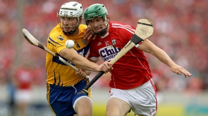 Clare's Patrick O'Connor in action against Cor forward Seamus Harnedy during last year's Munster Final