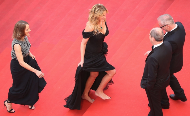 Julia Roberts walked barefoot up the Cannes red carpet steps. followed by Jodie Foster