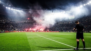 Aletico Madrid and Marseilles fans set off flares in the ground