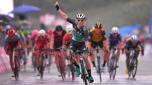 Bennett celebrates his win in stage 12