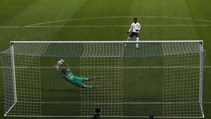Joey Koorevaar of the Netherlands saves a penalty from England's Folarin Balogun