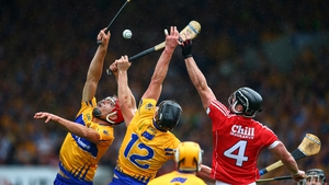 Clare's Peter Duggan and John Conlon compete with Cork defender Colm Spillane during the 2017 Munster final