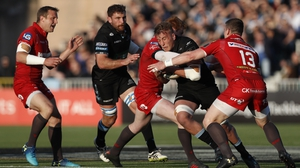 Scarlets remain on course to defend their title