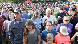 Thousands mourned the victims at a service last night