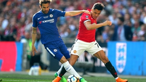 Cesc Fabregas of Chelsea battles for possession with Alexis Sanchez of Manchester United