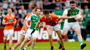 Armagh's Gregory McCabe and Seamus Quigley of Fermanagh battle for possession