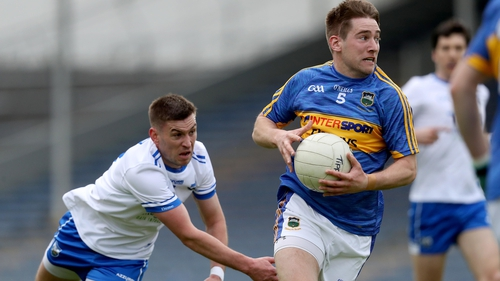 Tipperary's Bill Maher gets away from Gavin Crotty