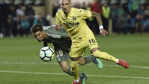 Luca Zidane (L) tries to block a shot on goal by Samuel Castillejo