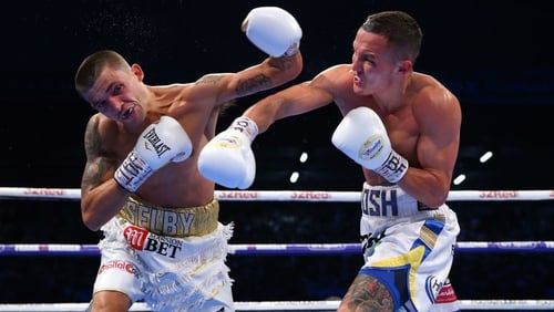 Josh Warrington lands a right shot on Lee Selby
