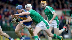 Jason Forde fights for possession with Seamus Hickey