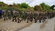 Members of the Defence Forces arrive at Rathmicheal to assist in search