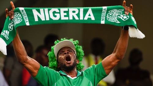 A Nigeria fan shows his devotion in the stands