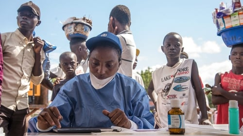 Nurses working with the World Health Organisation prepare to administer vaccines in Mbandaka