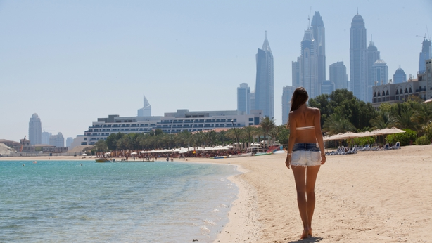 Summer vacation happiness carefree joyful woman walking on Dubai