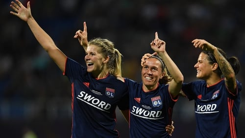 Camille Abily of Lyon (C) celebrates scoring her side's fourth goal with Ada Hegerberg (L) and Dzsenifer Marozsan