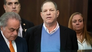 Harvey Weinstein stands beside his lawyer Benjamin Brafman in court