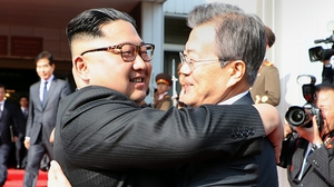 South Korean President Moon Jae-In (R) and North Korean leader Kim Jong-un hugging each other after their second summit in the North Korean side of the demilitarised zone