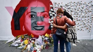 Two women stand at the Savita Halappanavar mural in Dublin today