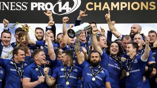 The retiring Isa Nacewa holds the Pro 14 trophy aloft after Leinster's 40-32 victory