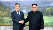 South Korean President Moon Jae-in (L) and North Korean leader Kim Jong-un yesterday