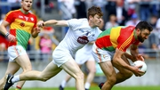 Carlow's Shane Redmond in action against Kildare's Kevin Feely