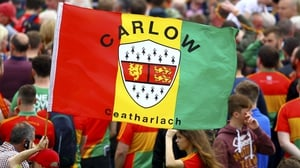 Carlow supporters celebrate their success