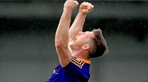 Michael Quinn celebrates at the full-time whistle