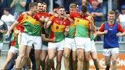 Ecstatic Carlow players celebrate at the final whistle
