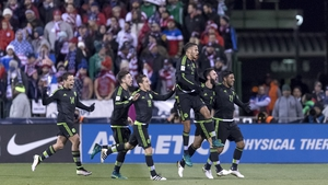 The Mexican players celebrate their late winner over the USA in a qualifier in Ohio