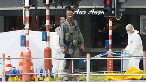 Forensic specialists examine one of the scenes where four people died, including the gunman
