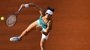 Caroline Wozniacki beat Georgina Garcia Perez in a flash