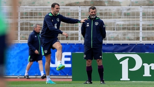 John O'Shea with assistant manager Roy Keane