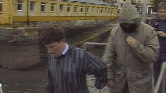 Martin Cahill and prison officer at Cobh pier, County Cork (1988)