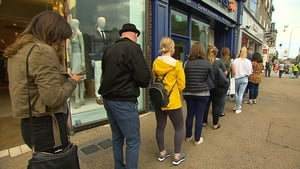 Customers queue up to take out cash at an ATM in Dublin today