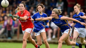 Orlagh Farmer of Cork in action against Jennifer Grant of Tipperary