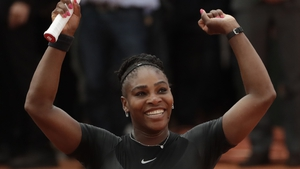Serena Williams salutes the fans