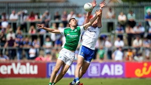Conall Jones and Dessie Ward battle for the ball