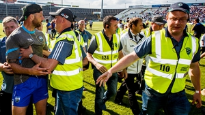 Waterford selector Dan Shanahan confronts the umpires after the game