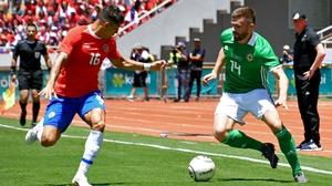 Costa Rica's Christian Gamboa (L) and Northern Ireland's Stuart Dallas vie for the ball